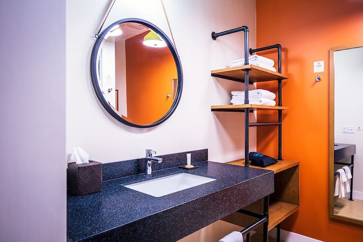 Lodge King room includes a spacious private bathroom with shower, Earth Therapy bath products and hair dryer.