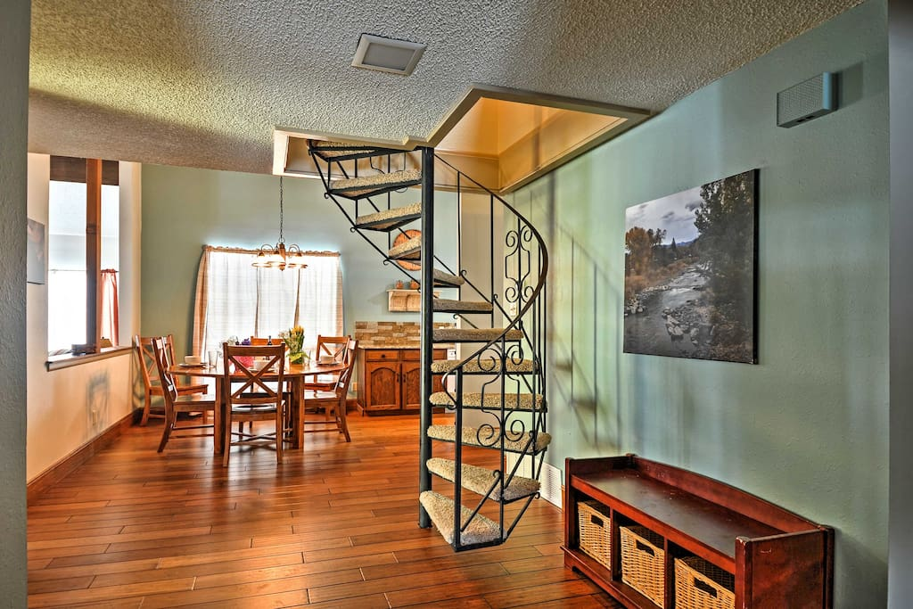 The charming spiral staircase leads to the loft area with additional sleeping.