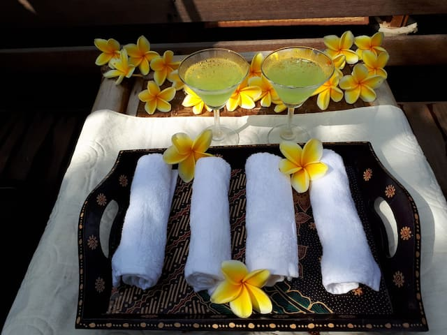 Enjoy our welcome drink and face towel.