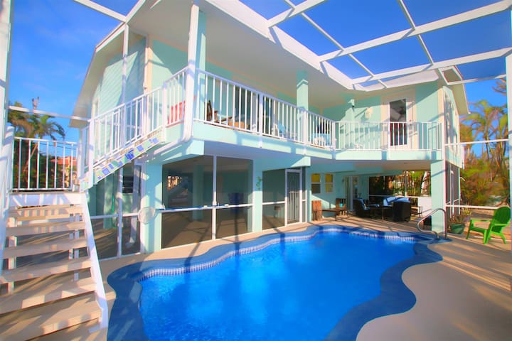 Beautiful Waterfront Home with Screened-in Pool by Sombrero Beach!
