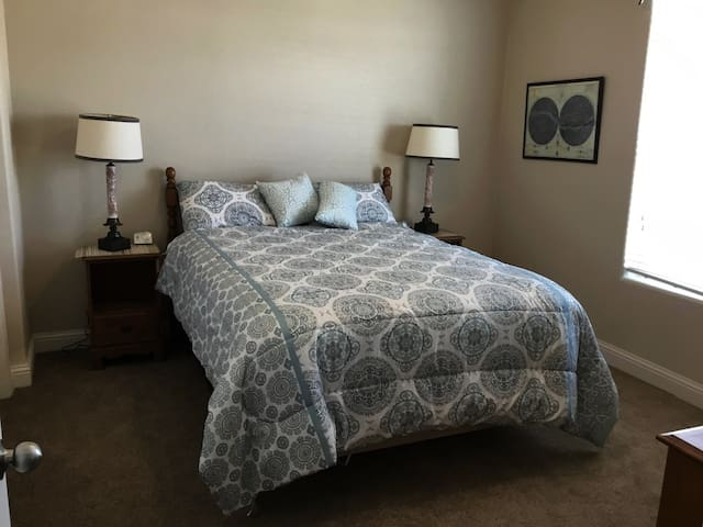 Second bedroom with queen sized bed. with ample space on either side of bed.