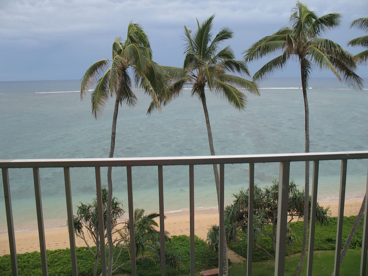 View of sandy beach & ocean from 7th floor, one floor below the penthouse with 550sq ft of living space.