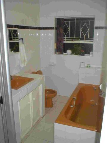 Shared bathroom: Shower, basin, toilet, bath.