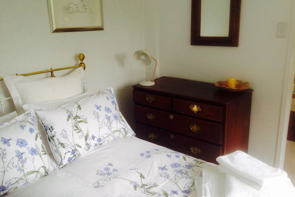 Oak dresser with fresh linen and towels provided