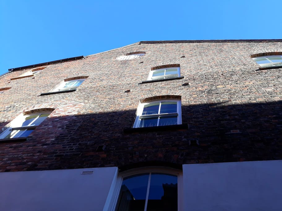 View of the apartment from below #historic building #converted mill #riverside apartment