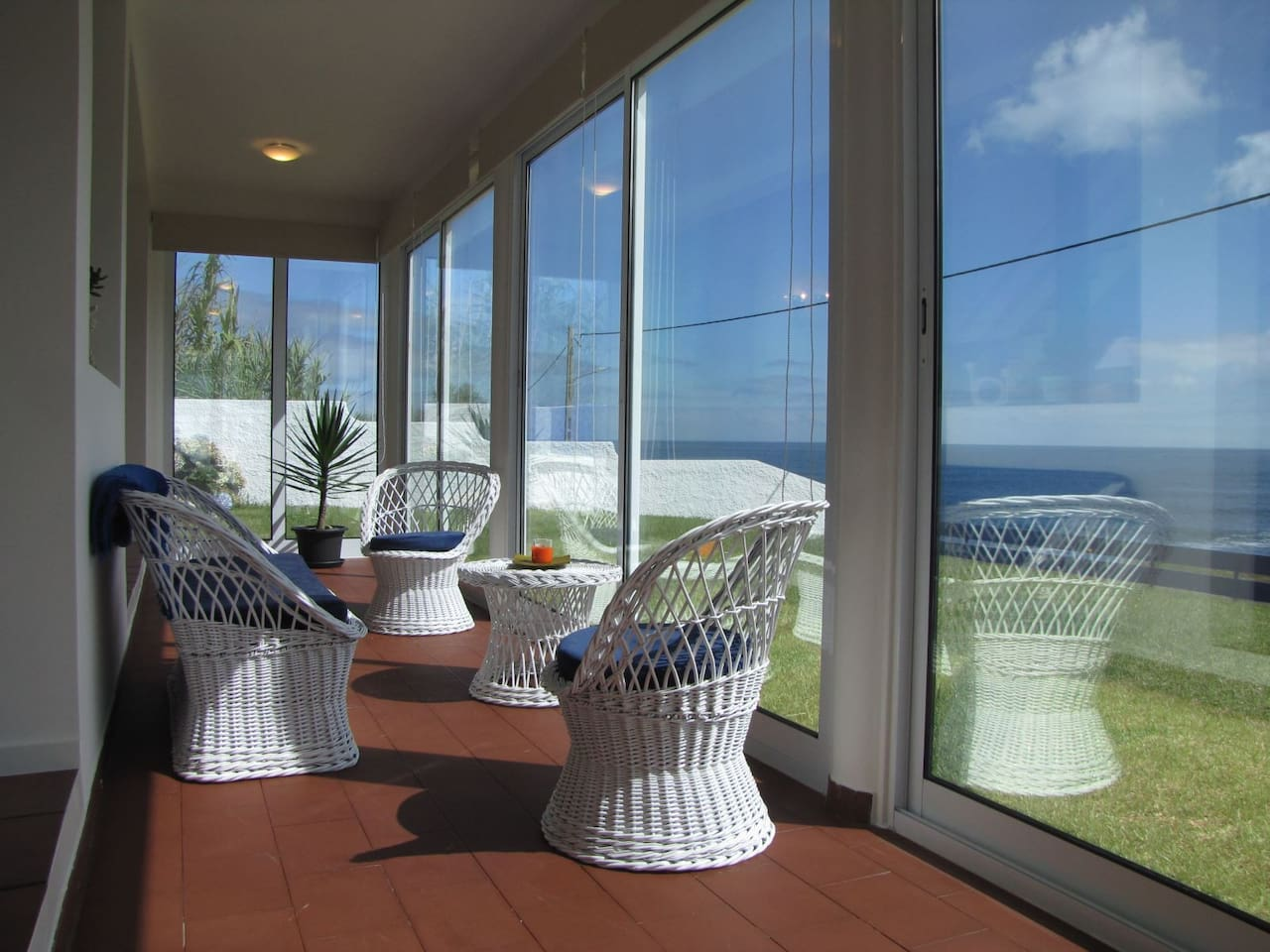 Sunroom facing ocean views