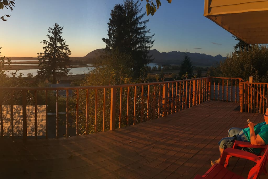 Enjoy evenings from the deck. Your horizon expands all the way to the twinkling lights of Nehalem at night.
