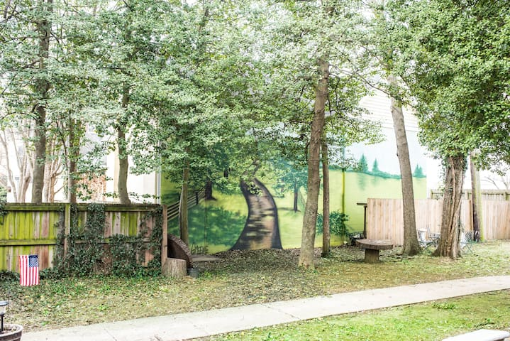 We've had a mural painted to depict the  original driveway leading to Main St.