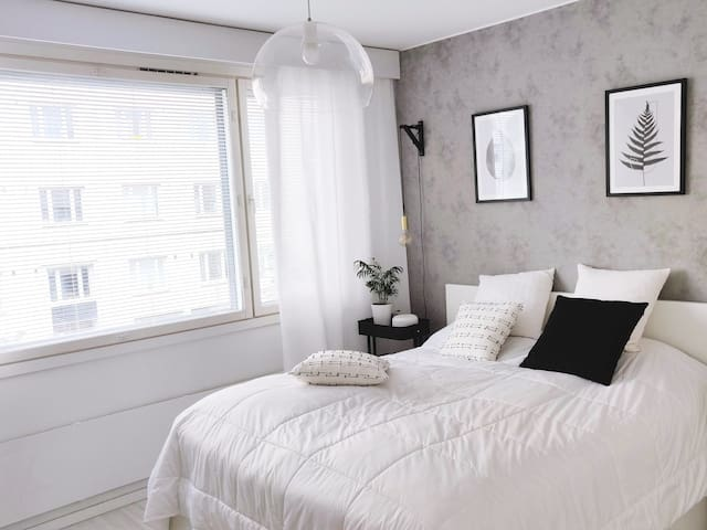 Bright bedroom with king bed, reading lamps and A/C