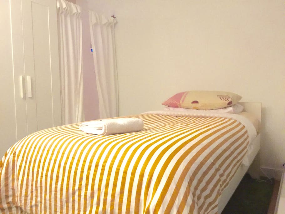 Another angle for the bed, the curtain acts as a 'door' to give you privacy.