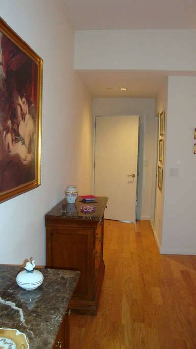 Bedroom view of two dressers and door into the bedroom.