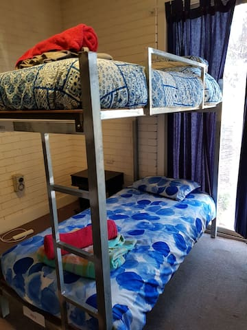 Hostel Room 6, Bed 6 (bottom bunk) of 8 beds