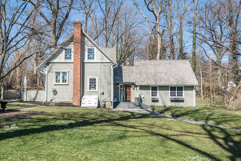 historic charm of a private home on 1/2 acre nestled in an upscale neighborhood