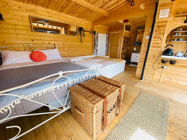 The lodge has a double bed, and a sofa bed that can be pulled out to make 2 single beds