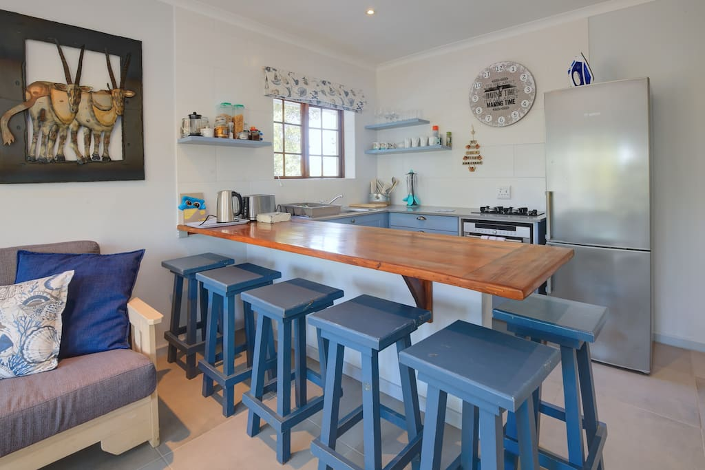 Owl Cottage - 2 bedrooms has a compact kitchenette, dining and lounge area.