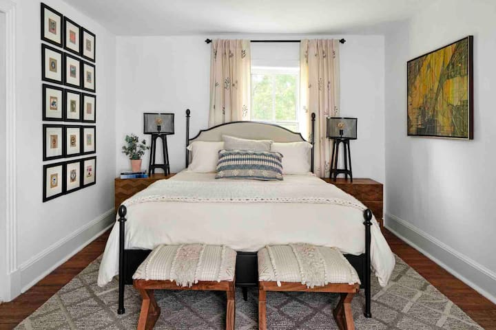 Middle bedroom with queen size bed and Restoration Hardware bedding.  All of our mattresses are a high quality foam material that our guests rave about.  The bedroom also has a dresser and a tv.