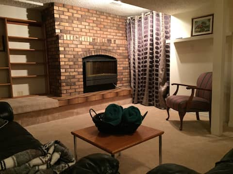 Bright Basement Suite living room area/fireplace