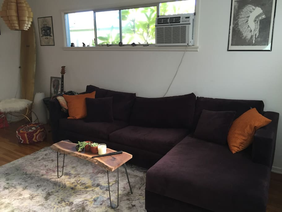 Comfortable couch with chaise lounge, pulls out into a foam top queen mattress! Also has A/C unit.