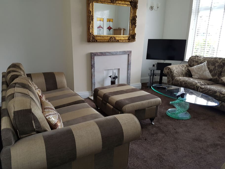 "Reception room with 3, 2 and 1 seater sofa. 40"" Led Samsung tv, Netflix and virgin media."