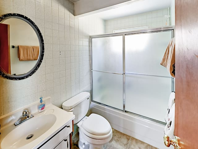 The 2nd bathroom has a shower/tub combination.