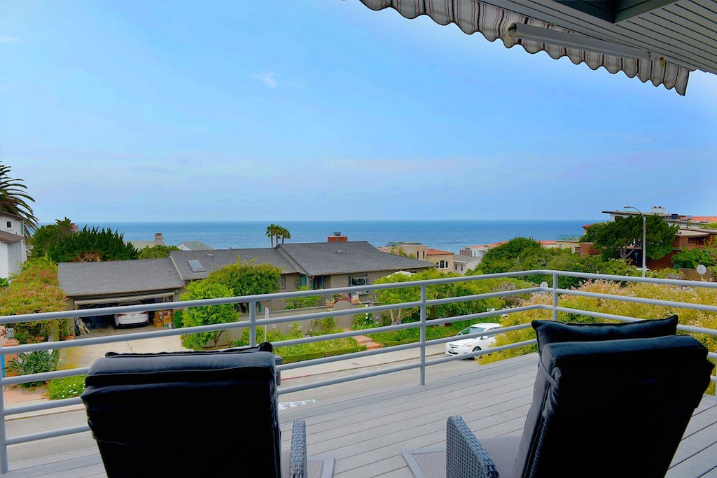Enjoy ocean views from your private deck just a few short blocks from the beach.