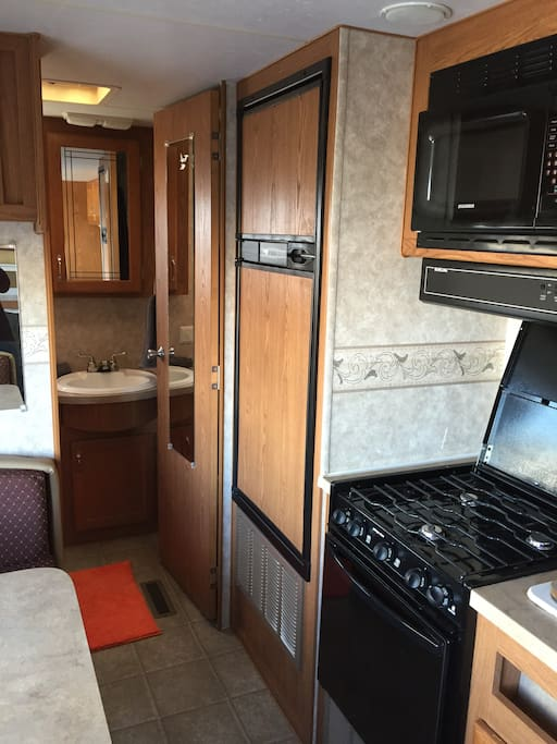 Nice, clean kitchen: stove, oven, microwave, sink