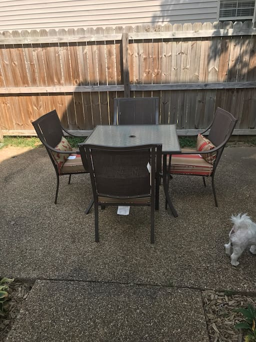 Outdoor dining table in courtyard