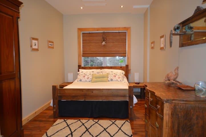 1st Floor Bedroom with Queen-sized Rustic Bed