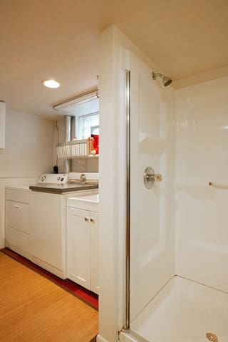 Shower, between bathroom area and kitchenette.  We have a new hot water heater!  And our water quality in Minneapolis is very good.