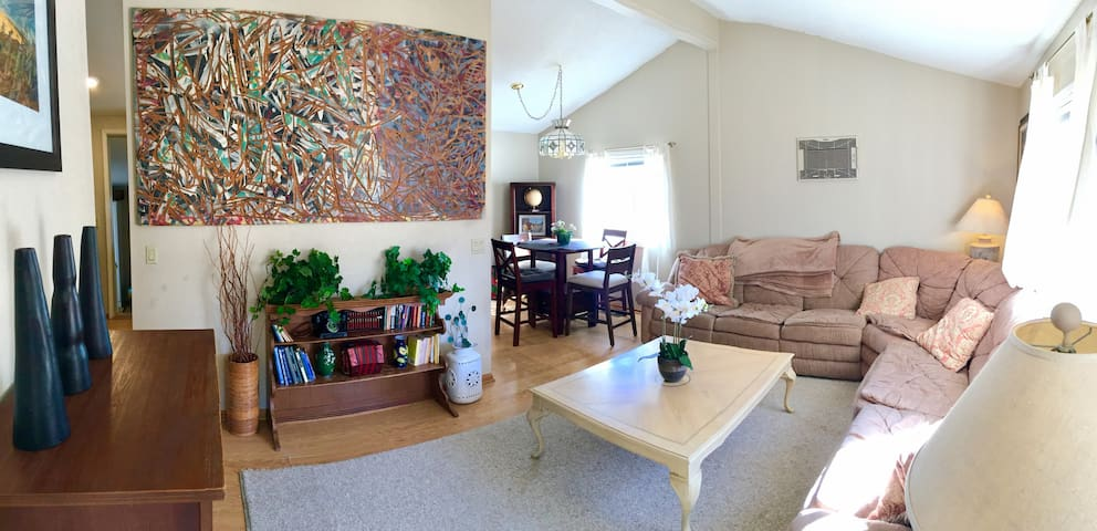 Living Room with a large wrap around couch