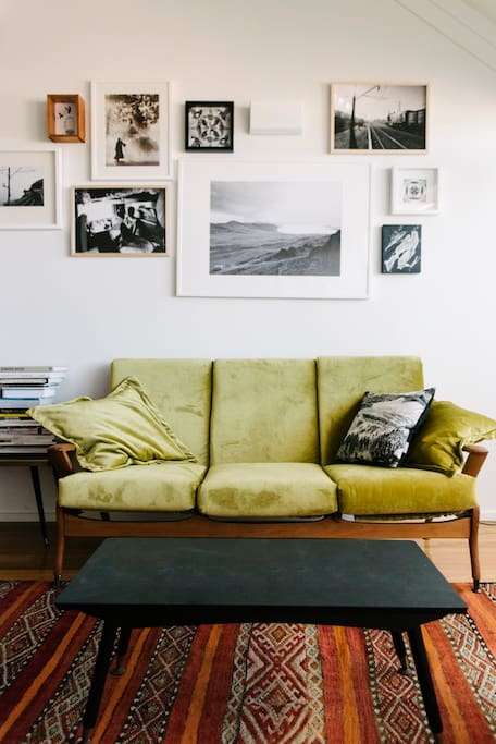 Freshly-upholstered vintage couches and a Moroccan rug