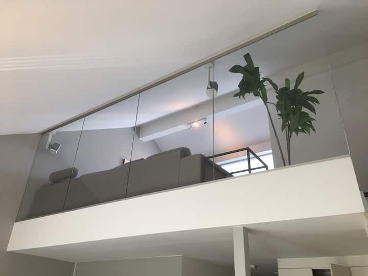 Modern & Central Two Story Penthouse
