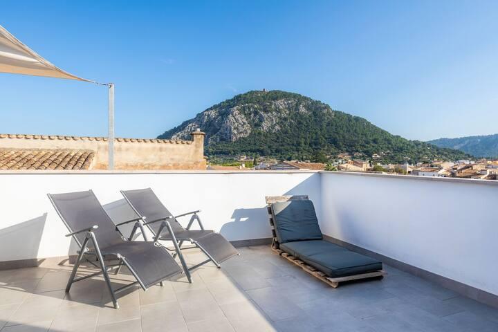 Maison de vacances romantique avec intérieur moderne, terrasse sur le toit, climatisation et Wi-Fi
