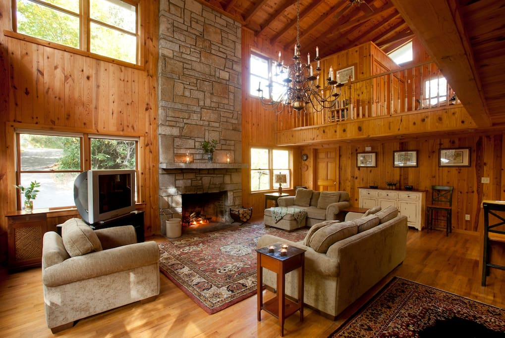 The living room as you walk through the front door. Fully functioning wood fireplace to keep you warm.