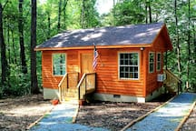 Our cabin is cozy and private.  The back deck overlooks the forest and winding creek.