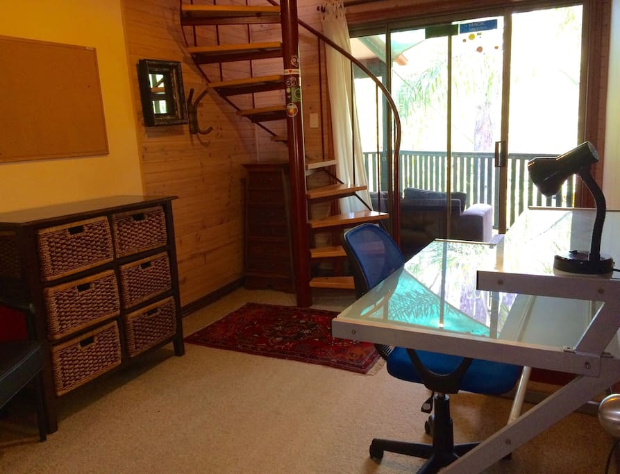 The room is on 2 levels. The lower level includes a desk with Wi Fi & ethernet network access. Access to the loft bedroom above is via a spiral staircase