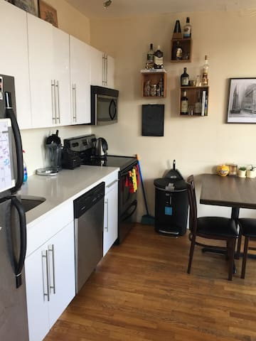 Kitchen includes oven, microwave, dishwasher, toaster, kettle and fridge. There's also spices and other condiments available for use.