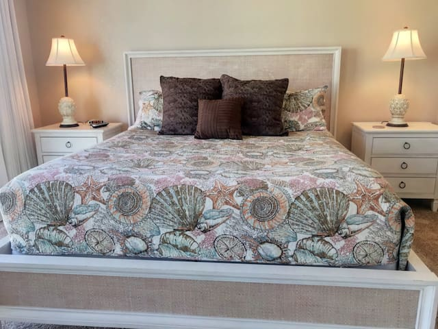 Master bedroom with king size bed, balcony, flatscreen TV and private bathroom