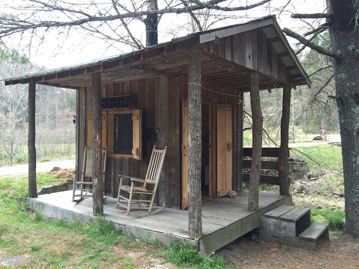 Riverside Cozy camping cabin