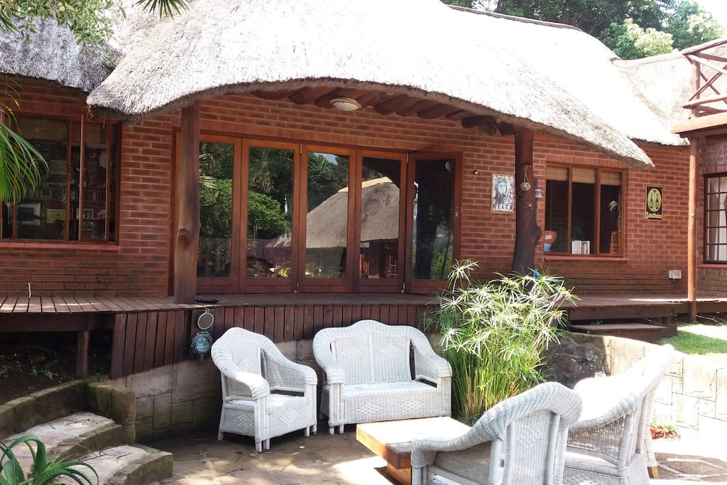 Private Guest Suite which has stacking doors that lead onto a wooden deck and entertainment area.