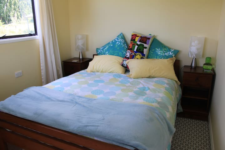 Bedroom has a very comfortable queen size bed with electric blanket