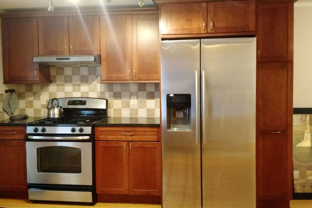 New stainless steel appliances in a welcoming kitchen make cooking a breeze