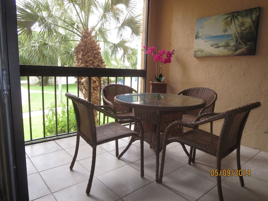 Enjoy morning coffee on screened deck with relaxing view of lake.