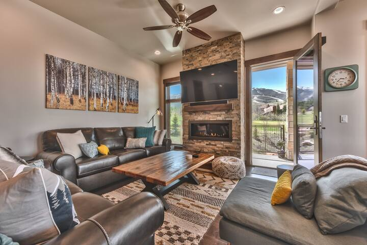 "Comfortable Mountain Contemporary Furnishings, including a queen sleeper sofa, with a 65"" Smart TV, Apple TV, Gas Fireplace, and Deck Access"