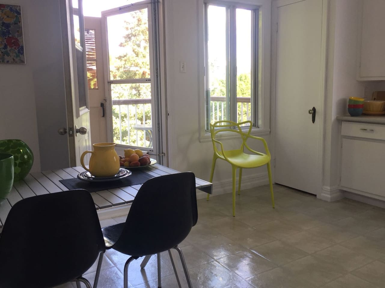 Bright and airy eat-in kitchen with balcony