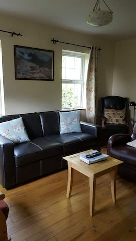 Bright, comfortable sitting room with double sofa bed, and reading area.