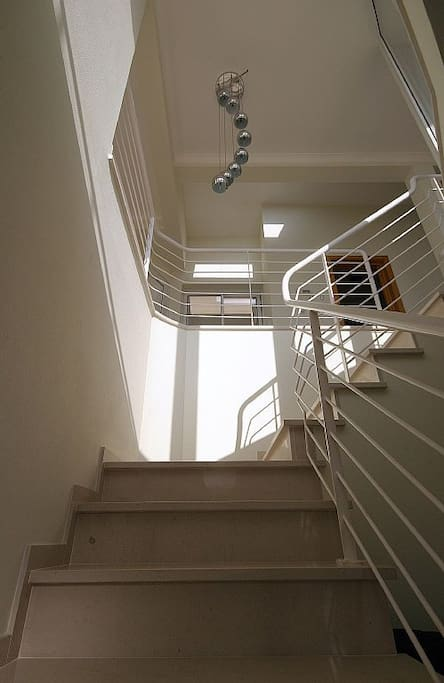 Stairs and galleried landing to living area