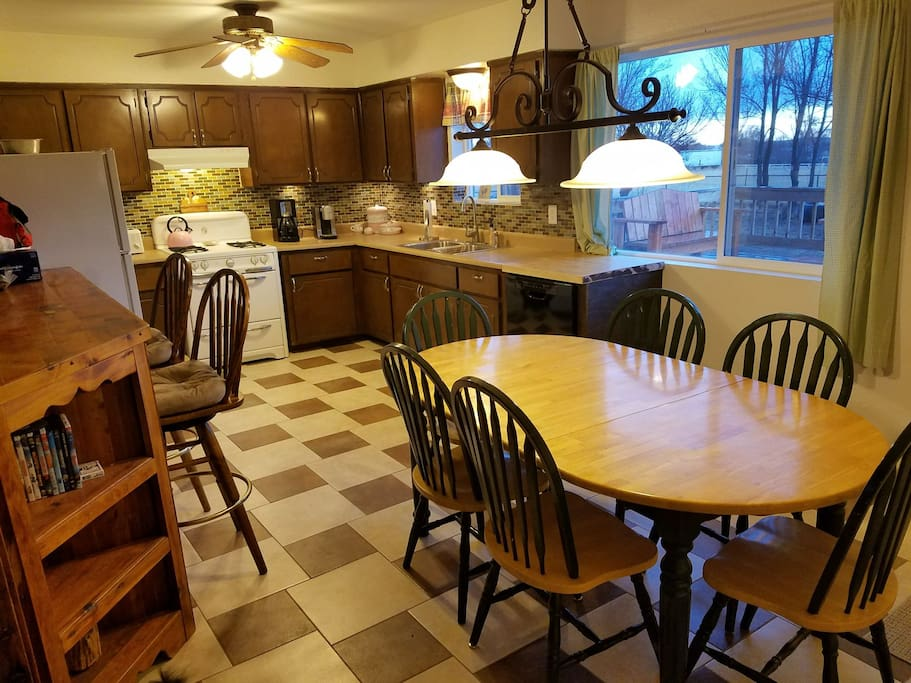Fully stocked kitchen with ample seating.  coffee maker, toaster, gas stove, toaster oven, microwave.