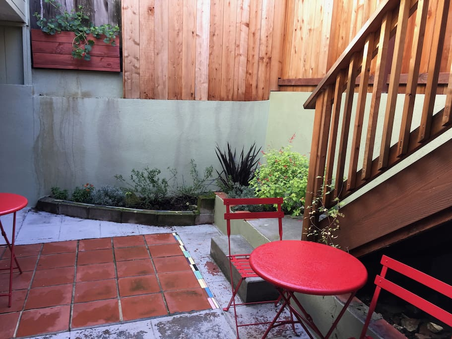 Private landscaped patio with access to deck