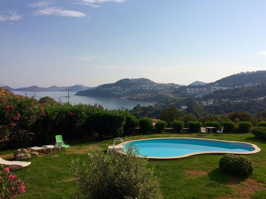 Sunbathe by the pool and enjoy lovely sea views